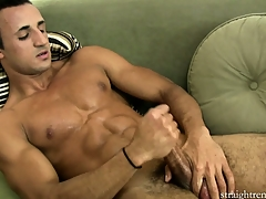 Lying vulnerable along to couch, along to young timber jerks his heavy cock until he enjoys intense respect