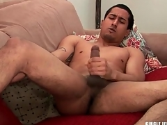 Cute guy with shaved bull masturbates and cums