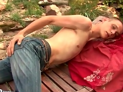 Atrophied guy strips in the gradate gather up with strokes outdoors