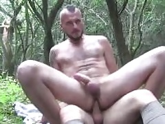 Two horny guys sucking each others cocks deep in the outback