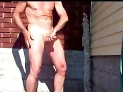 Mature amateur dude scraping his Hawkshaw beside the driveway